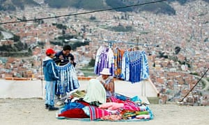 An Aymara woman sells clothes in the market of El Alto on the outskirts of La Paz