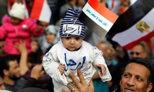 The baby's hat in Tahrir Square, Cairo, reads 'Leave'