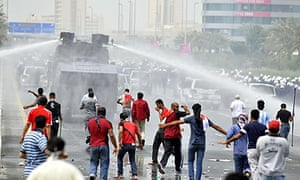 Police fire tear gas and water cannons at protesters in Manama, Bahrain.