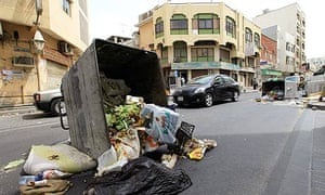 Upturned bins line a street in the centre of Manama after protests in the Bahrain capital.