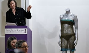 The hammer goes down to close the sale of the see-through knitted lace dress worn by Kate Middleton
