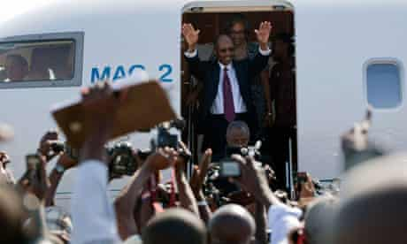Haiti's former president, Jean-Bertrand Aristide, with his wife Mildred arrives in Port-au-Prince