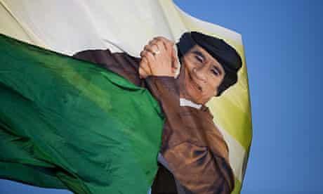 A flag with Muammar Gaddafi's image is flown by his supporters in Tripoli