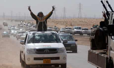 Libyan rebel fighters flee