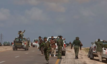 Rebel fighters on the outskirts of Ajdabiya