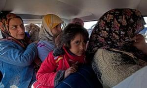 Civilian refugees flee the eastern Libyan town of Ajdabiya