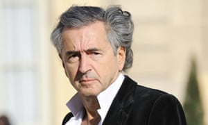 Bernard Henri-Levy arrives for a meeting between Libyan rebels and Nicolas Sarkozy in Paris.