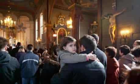 Marcin Baniak and his daughter Amelia at mass