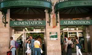 Customers leaving Marks and Spencer food and department store in Paris in June 1996