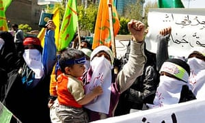 Iranians condemn the killing of pro-democracy activists in Bahrain, during a protest in Tehran.