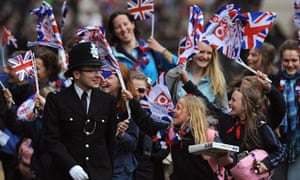 Royal wedding revellers surge along the Mall