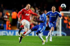 Chelsea v Man Utd: Michael Essien catches Wayne Rooney as they clash in the middle of the park