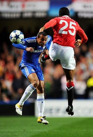 Chelsea v Man Utd: Ashley Cole and Antonio Valencia tussle for the ball