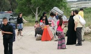 Syrians flee on foot into Wadi Khaled