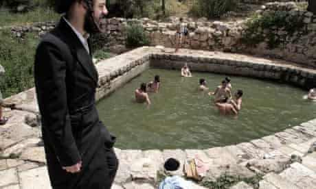 Ultra-orthodox Jewish teenagers swimming in the village spring