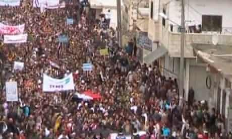 A still from an amateur video on April 22, 2011 protesters marching during a demonstration in Deraa