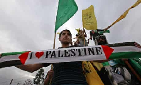 Palestinians celebrate the reconciliation agreement
