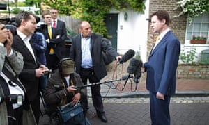Nick Clegg speaks to reporters outside his home in Putney