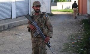 Pakistani soldier outside Bin Laden compound