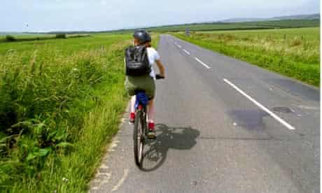 Cycling along an empty road on th Isle of Wight