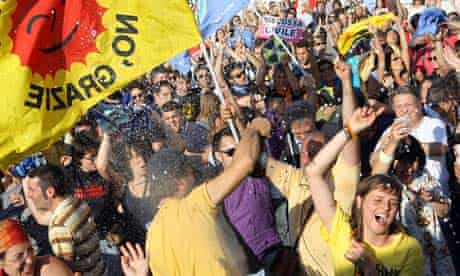 People celebrate following results in Italian referendums on water and nuclear power in Rome