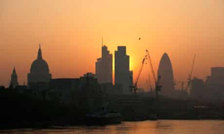 The sun rises above the City of London