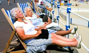 Snoozing in deckchairs at Weymouth beach in Dorset.