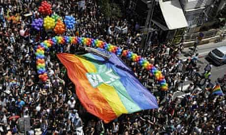 Thousands of people take part in the annual Gay Pride parade in Tel Aviv, this month.