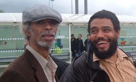 Malik with Gil Scott-Heron on tour in 2009.