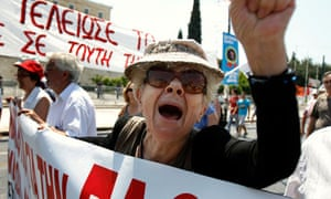 A Greek protester shouts slogans against the government's austerity measures in central Athens.