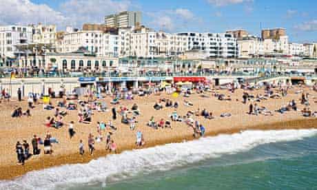 People enjoy the weather on Brighton beach.