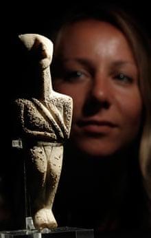 British Museum employee Esme Wilson with marble Cycladic figurine