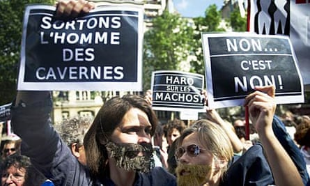 Female protesters hold up placards at a Paris demonstration