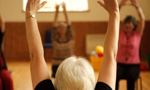 Elderly people in aerobics class