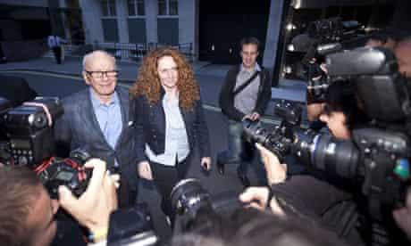 Rupert Murdoch, Rebekah Brooks and James Murdoch at the Stafford Hotel in London