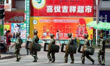 Chinese patrol Urumqi