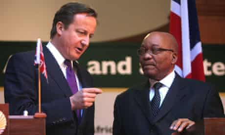 MDG : South African President Zuma listens to David Cameron during a press conference in Pretoria