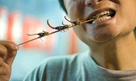 Eating a scorpion kebab