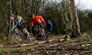 A group of mountain bikers speeds down the Timberland Trail at Ashton Court in Bristol