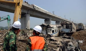 Rescuers at crash site in Wenzhou, China