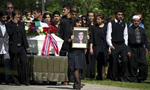 friend of Bano Rashid (18), one of the Utoya victims of the massacre walks ahead of her coffin