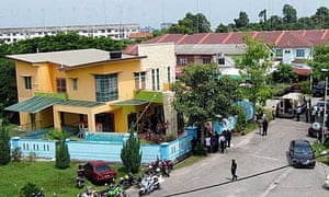 Malaysian police surround a kindergarten where a man took some 30 children and staff captive in Muar