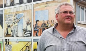 Political geographer Pete Shirlow in front of a mural in Belfast