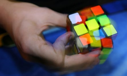rubik's cube in a player's hand