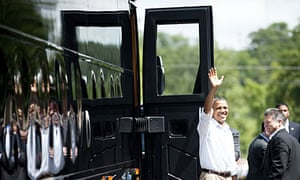 Barack Obama waves before boarding his bus outside  in Cannon Falls, Minnesota.