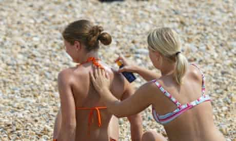 Beachgoers Relax On Beach At Eastbourne