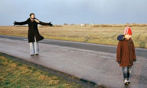 A mother and son walk through the Kent marshlands near Dungeness.