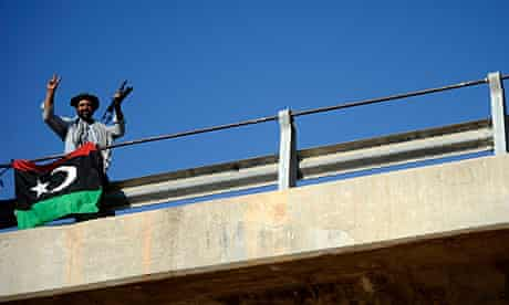A Libyan rebel fighter on the captuyred 27th Bridge, which leads into the centre of Tripoli.