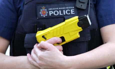 Greater Manchester police officer holding a Taser