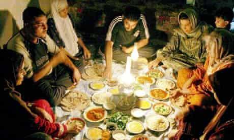 An iraqi family have a pre-dawn breakfast